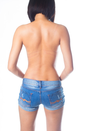 Sexy back of woman wearing blue jeans photo