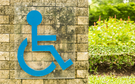 Sign for physically disabled on the wall photo