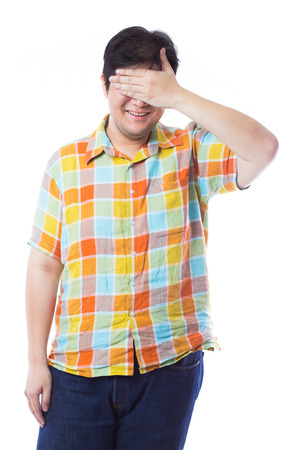 unsighted: Happy young man covering eyes Isolated on white  background