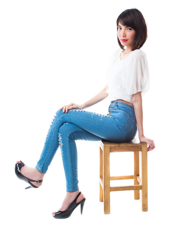 Attractive young woman sitting on chair
