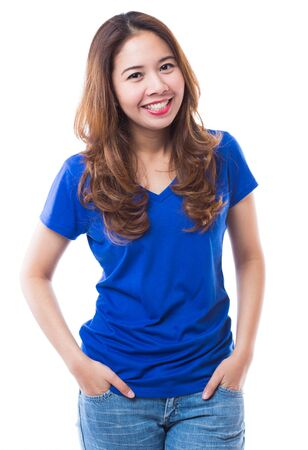 Beautiful brunette girl in jeans and blue t-shirt smiling very happy  on white background photo
