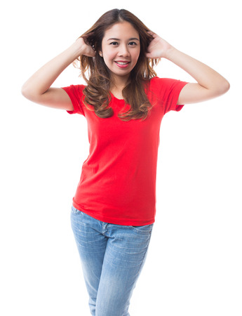 asian model: Beautiful brunette girl in jeans and red t-shirt smiling on white background