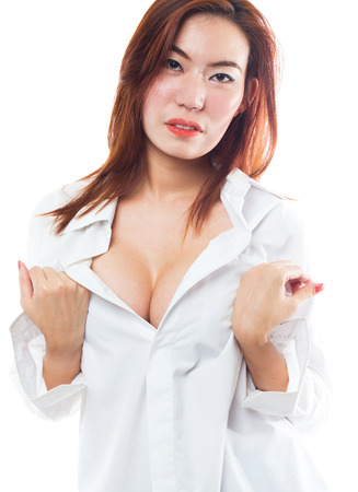 chinese sex: Sexy asian model woman showing her sexy breast in lingerie with shirt opened by hand on white background