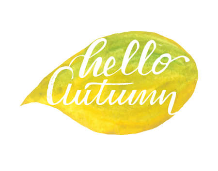 Hello autumn hand lettering phrase on yellow watercolor maple leaf background