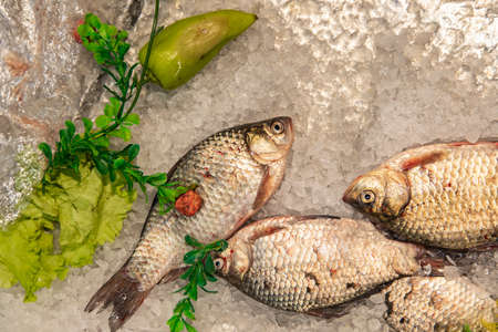 frozen fish decorated by vegetables product mall background food photography