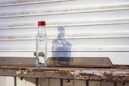 alcohol problem empty glass bottle in urban dirty environment background