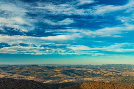 aerial top view highland hills valley horizon line background landscape scenic view dramatic vivid blue sky cloudscape copy space for your text Stock fotó
