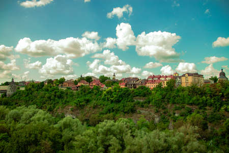 eco friendly European modern city houses landmark scenic view surrounded bu green trees foliage park outdoor natural environment on vivid blue sky white clouds background empty copy space Reklamní fotografie