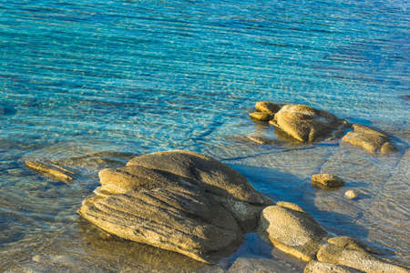 picturesque coast landscape sea lagoon in morning sun rise time stones and bright colorful aquamarine water background scenic view with empty copy space for your text