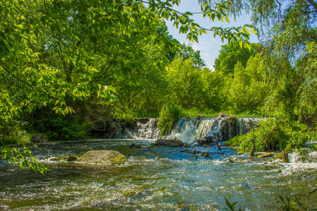 summer time colorful landscape river stream small waterfall in forest nature environment space 스톡 콘텐츠 - 139126801