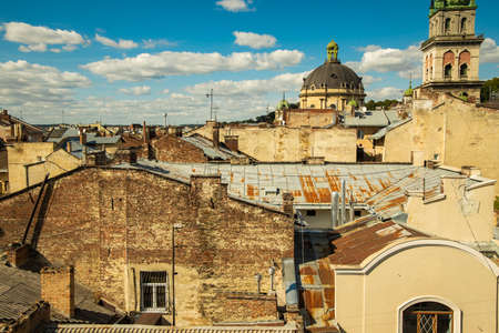 poor slum medieval city ghetto streets historical center district with very old abandoned houses and urban view on cathedral dome and town hall background space Stock Photo