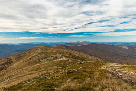 Carpathian Mountains landscape scenic view dirt lonely trail route along highland ridge in dramatic moody weather
