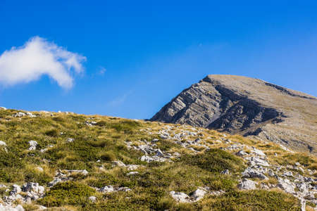 Great edge on highland hill mountain ridge nature landscape, clear weather time with blue sky and shadows from clouds, copy space for your text here Banco de Imagens