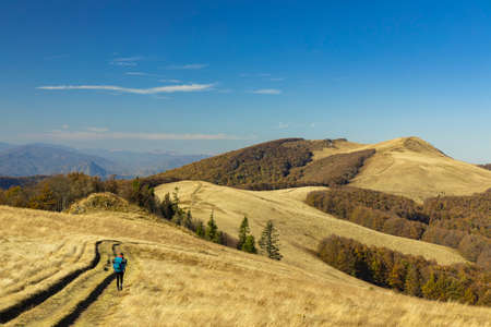 mountain landscape hiking life style photography of walking backpacker girl on highland hills autumn moody season weather nature environment scenic view copy space Zdjęcie Seryjne