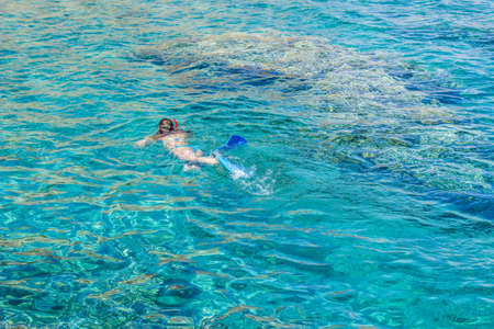 life style water activities swimming woman in Red sea scenic view foreshortening from above in summer time season weather