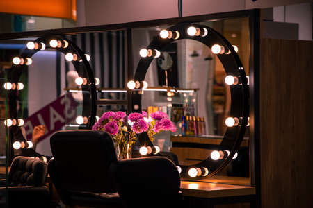 beauty salon interior design space armchair and mirrors with inscription sale in reflection soft color illumination and no people inside environment