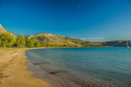 spring colorful scenery landscape of sand beach in Greece waterfront coast line sea bay copy space Zdjęcie Seryjne