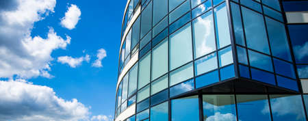 architecture exterior facade building glass windows wall design panoramic urban landmark city view on vivid blue sky white clouds background space for copy or your text here 免版税图像