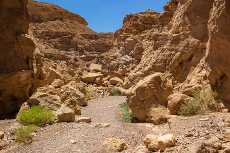 soft focus sand stone canyon passage between rocky mountains dry global warming scenic view concept in Israeli desert Negev place