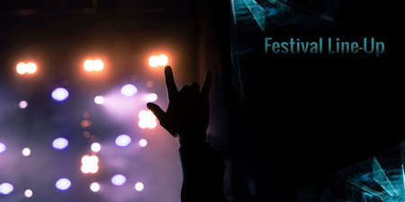 rock music festival poster lineup pattern flyer concept with human hand on stage illumination spot light background and black space for your text here Фото со стока