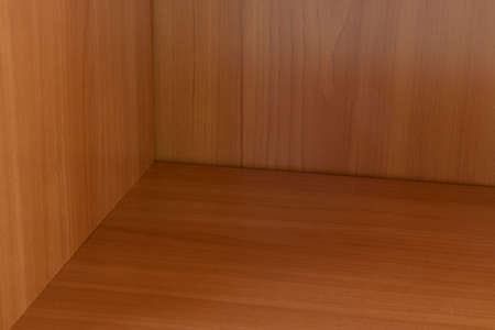 wooden shelf in wardrobe geometry lines and angles shapes wood material textured surface furniture background object pattern 写真素材