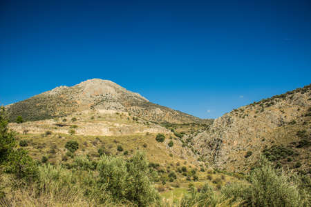 Greece mountain forest natural panorama of country side scenery landscape with some ancient ruins in bright evening sunset yellow lighting clear weather time
