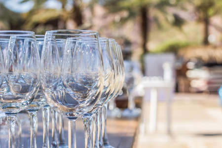 soft focus wine glasses bar patio cafe outdoor space in garden place with blurred unfocused background
