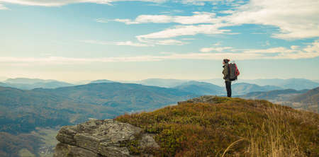 travel life style backpacker man stay and enjoy by beautiful peaceful moody highland mountains landscape scenic view in autumn season time of October month