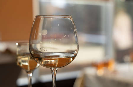 glass of wine banquet hall space blurred background view