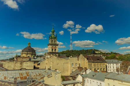 Lviv old city roof top landmark view Eastern European heritage touristic site in Ukraine summer clear weather day time medieval urban picture