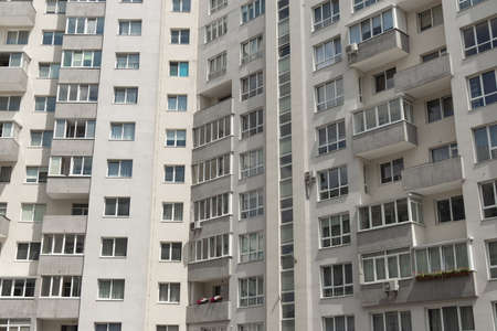 rustic living apartments building architecture background Eastern European common house object ugly gray walls and windows Фото со стока