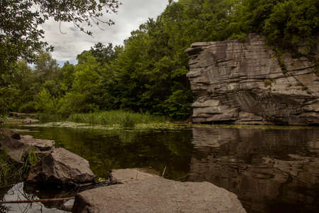 moody landscape scenic view of river canyon rocky environment in cloudy weather day time Фото со стока