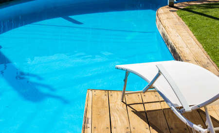 resort swimming pool side deck chair lounge zone summer sunny weather day time wallpaper poster concept copy space