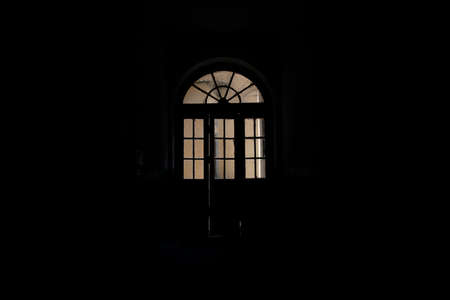 ancient arch shape door way in old house hall inside space black background indoor environment architecture indoor object