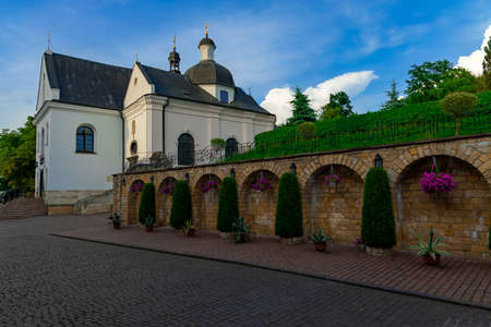 Greek Catholics church and monastery courtyard beautiful space with pavement street and landscaping exterior wall facade religion urban outdoor