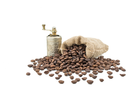 Coffee sack with beans and grinder. Isolated coffee bag on white background. Coffee beans isolated. Stock Photo