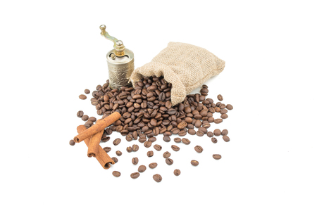 Coffee sack with beans, grinder and cinamon. Isolated coffee bag on white background. Coffee beans isolated.