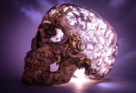 Skull with carved pattern adn light inside.