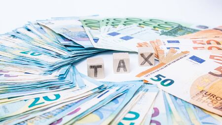 Concept tax and debt payment. Euro banknotes Laid out in a cicircle on white background. Money finance earning sector concept. Copy space for text. Stack of money wealth, lottery prizes.