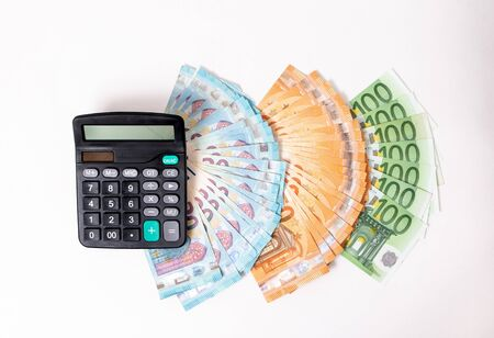Loans and debts concept. Euro banknotes Laid out in a fan on white background. Money finance earning sector concept. Copy space for text. Stack of money wealth, lottery prizes or banking crise.
