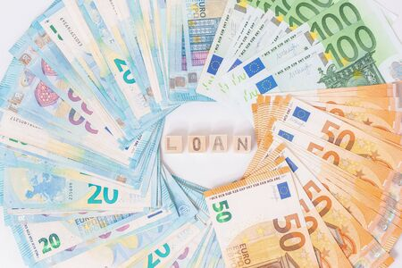 Loans and debts concept. Euro banknotes Laid out in a cicircle on white background. Money finance earning sector concept. Copy space for text. Stack of money wealth, lottery prizes or banking crises.
