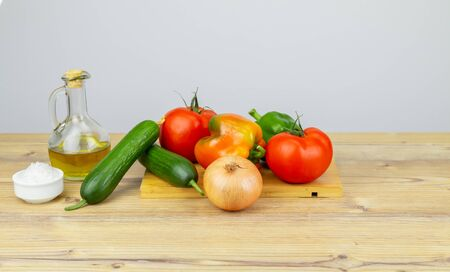 Ingredients for Greek Salad on wooden background. Vegetables on wooden background. Healthy food, Mediterranean diet. Copy space for text. Salad ingredients, tomatoes, feta, cucumber, onion, olive oil. Stok Fotoğraf