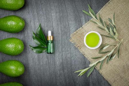 Cosmetic avocado oil in dropper bottle, mock up. Glass bottle. Avocado and olive oil mock up. Natural eco skin care cosmetic. Avocado Essential Oil dropper mock up.