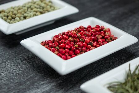 Red pepper or Pink pepper. Colorful spices in white bowls Seasonings for cooking. Natural Herbs & Spices.