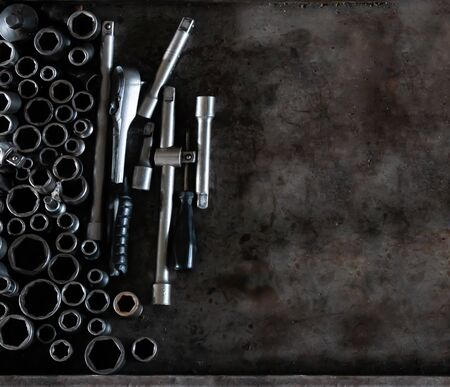Mechanic tools set on metal background. Vintage style image of blank space on metal, lot of old tools. Copy space. Car service and repair concept. Tools on working table. Banco de Imagens