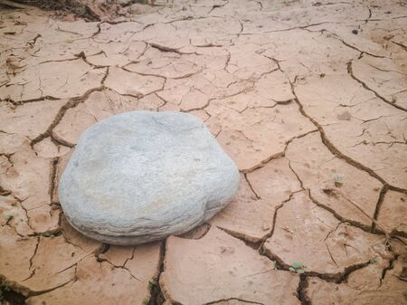 Cracked ground and stone. The global shortage of water on the planet. Global warming and greenhouse effect concept. Copy space.