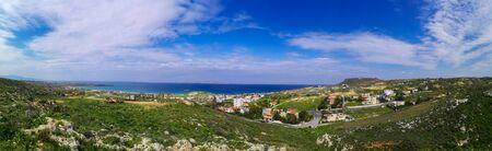 Beautiful Karteros beach. Crete island. Paradise beach with mountains. Travel tourism wide panorama background concept.