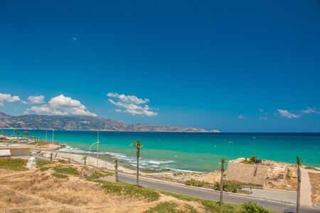 Heraklion city, beach view. Central street of Heraklion with sea and sky.