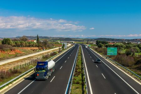 Route from Greece to Turkey. Greek Egnatia road with trucks and cars traffic. Greece, Evros, Alexandroupoli. Banco de Imagens
