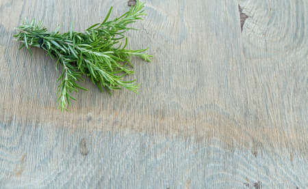 Beautiful Greek wild rosemary on natural wooden background. Copy space for text. Space for you product. Banco de Imagens